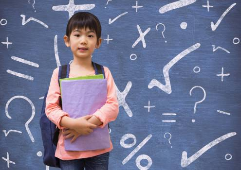 Girl with bagpack and books standing against mathematical background Free Photo
