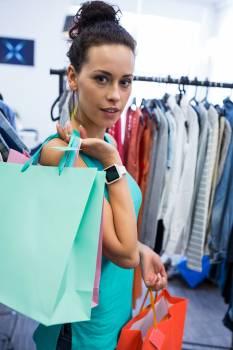 Beautiful woman carrying shopping bags #412707