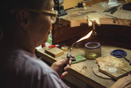 Craftswoman using blow torch #412711