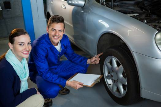 Mechanic showing customer the problem with car #412720