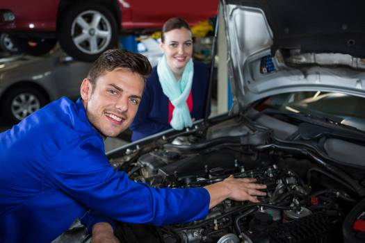 Mechanic showing customer the problem with car #412756