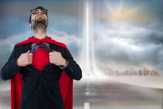 Businessman in super hero costume tearing shirt against cloudy sky #412774