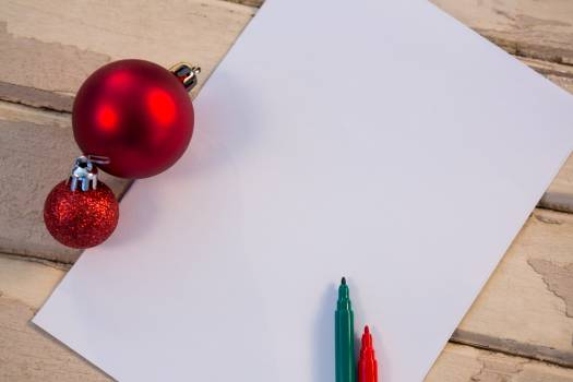 Christmas bauble ball felt pen and paper on wooden plank #412783