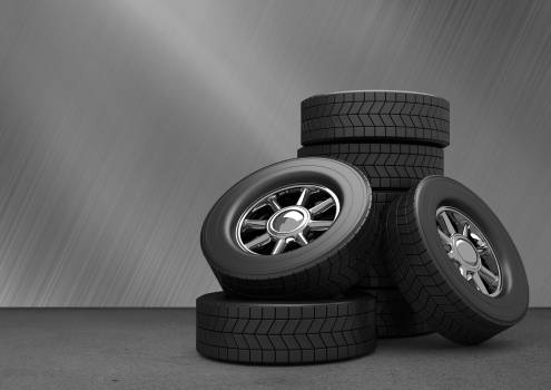 Tyres kept on grey background #412815