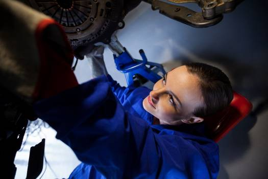Female mechanic repairing a car #412834