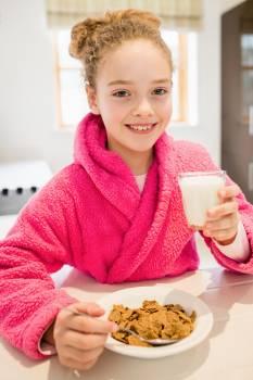 Cute girl having breakfast in kitchen #412839