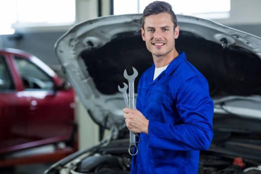 Mechanic holding wrench Free Photo