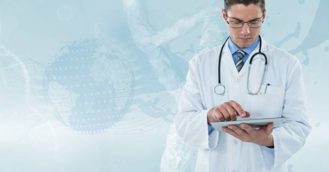 Doctor (men) with technological background working with his tablet Free Photo