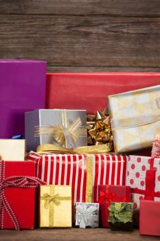 Various wrapped gift box on wooden table #412897