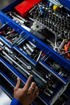 Mechanic selecting work tool from toolbox #412900