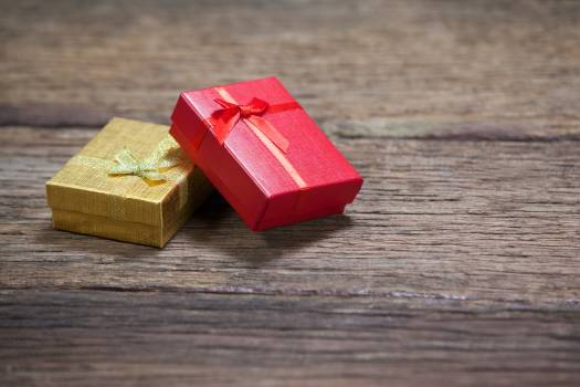 Two christmas gifts kept on wooden table Free Photo