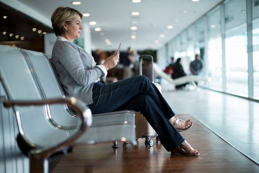 Businesswoman using mobile phone in waiting area #412947