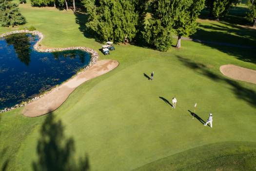 Golfers in beautiful golf course on a sunny day Free Photo