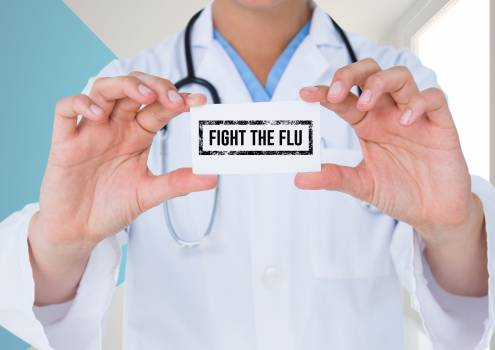 Doctor holding placard with text fight the flu text #412962