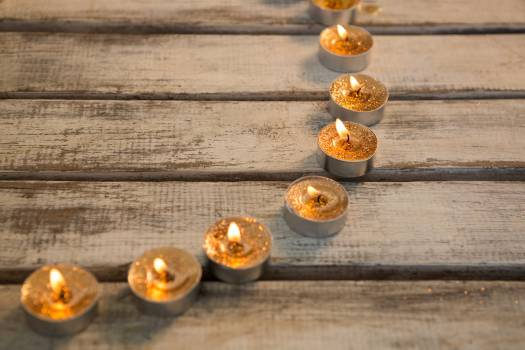Candles burning on wooden plank #412965