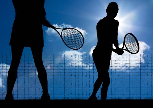 Silhouette of tennis player with rackets against sky background #412967