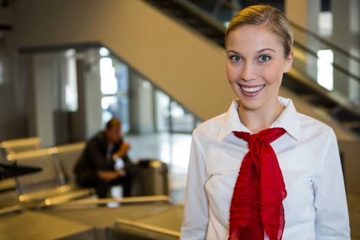Smiling female staff at the airport terminal #412974