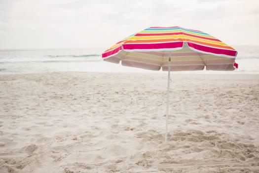 Beach umbrella at tropical sand beach #412976
