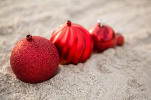 Christmas baubles arranged on the sand #412987