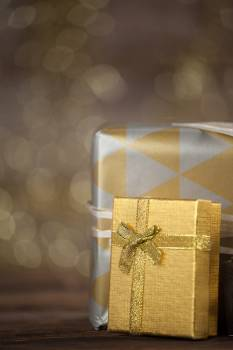 Close-up of wrapped gift boxes on wooden table #412996