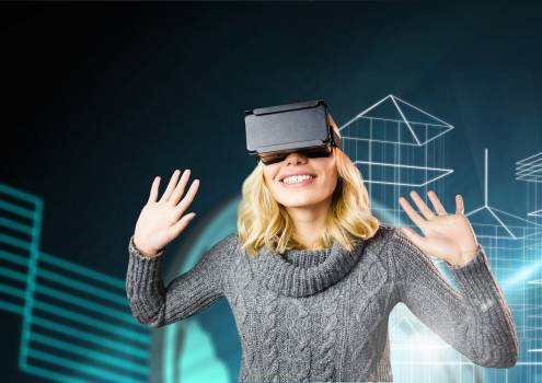 Woman using virtual reality headset against digitally generated background #413001