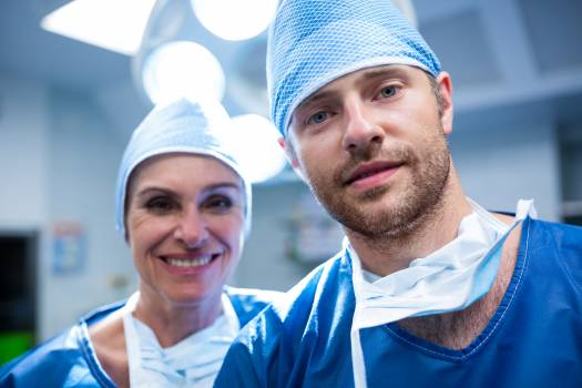 Portrait of surgeons standing in operation room #413018