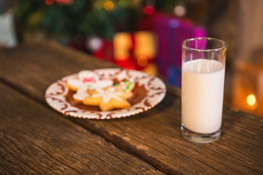 Gingerbread cookies with a glass of milk on wooden table #413019
