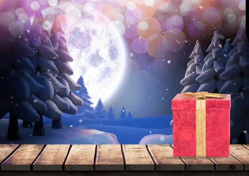 Gift box on wooden plank against snowy background Free Photo