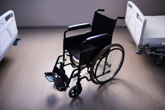 Empty wheelchair in ward #413070