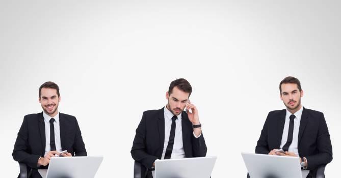 Multiple image of businessman using laptop against white background Free Photo