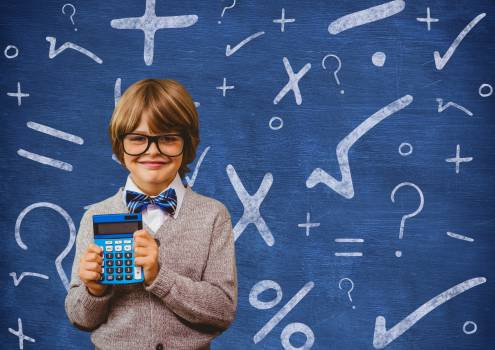 Schoolboy holding calculator in front of a chalkboard #413108