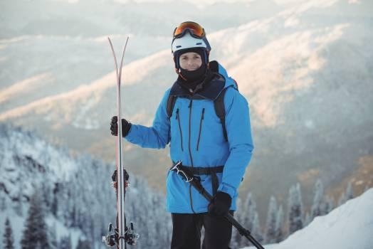Portrait of skier standing with ski #413123