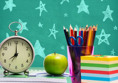 Various stationeries, alarm clock and apple #413168