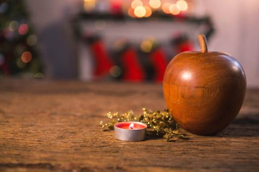 Wooden apple with tealight candle on wooden table #413181