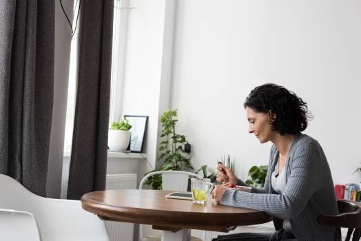 Woman using digital tablet while having breakfast Free Photo