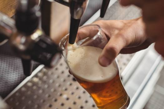 Close-up of bar tender filling beer from bar pump #413230