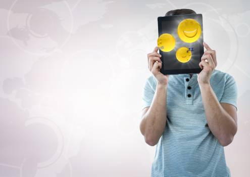Man tablet over face showing emojis with flares against white interface #413231