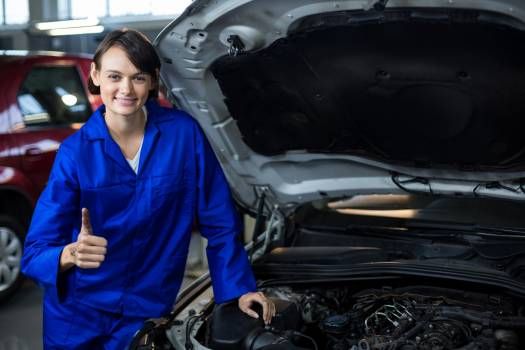 Portrait of female mechanic showing thumbs up #413233