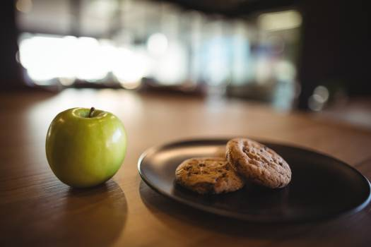 Green apple and cookies on table #413238