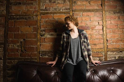 Beautiful woman sitting on sofa #413241