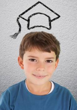 Smiling schoolboy with mortarboard above head Free Photo