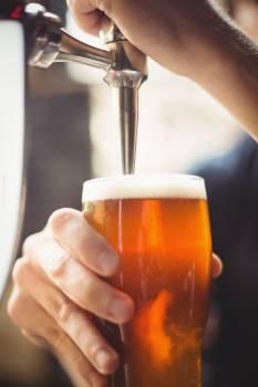 Close-up of bar tender filling beer from bar pump #413258