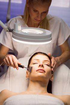 Dermatologist performing laser hair removal on patient #413377