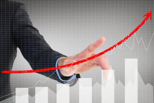businessman pointing at rising graph #413413