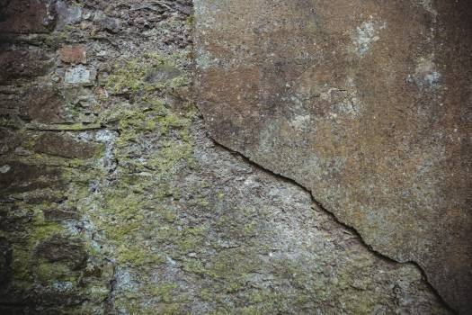 Close-up of weathered stone wall #413425