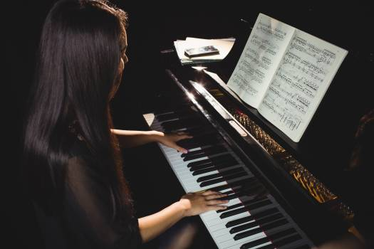 Female student playing piano #413437