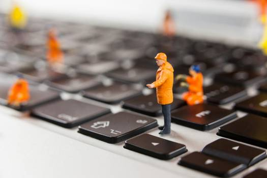Miniature workmen repairing a laptop keyboard #413448