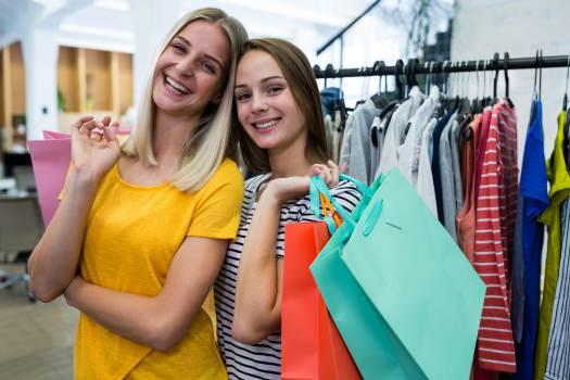 Two beautiful woman carrying shopping bags #413489