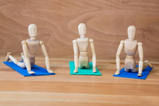 Figurines performing stretching exercise #413514
