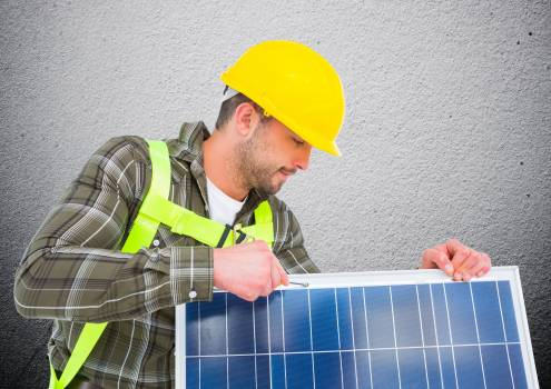 Composite image of man fixing solar panel #413525